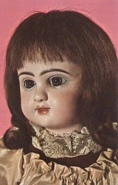 Featured is a postcard image of an antique doll - a 19th century French Fashion Doll made by Pannier.  The doll has paperweight eye, pierced ears, a composition body, and a human hair wig.  The original unused postcard is for sale in The unltd.com Store.